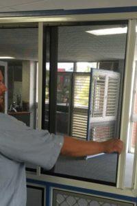 Chris Demonstrating Crimsafe double sliding grilles 1