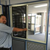 Chris Demonstrating Crimsafe double sliding grilles 2