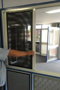 Chris Demonstrating Crimsafe double sliding grilles 2
