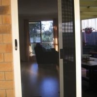 Crimsafe Sliding door with pet flap 2