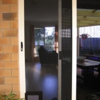 Crimsafe Sliding door with pet flap