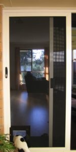 Crimsafe Sliding door with pet flap mod (2)