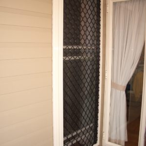 Mid Duty Fixed Grille on Double Hung Window